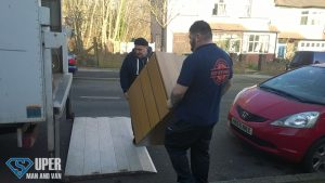 Men loading a piece of furniture